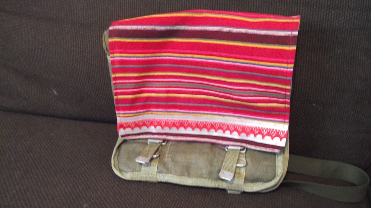 An army bag pimpt with some Estonian look-a-like folk costume material and lace.  @http://www.facebook.com/Kansanomaisetkankaat