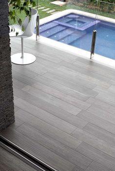 Wood look tiles around pool maybe
