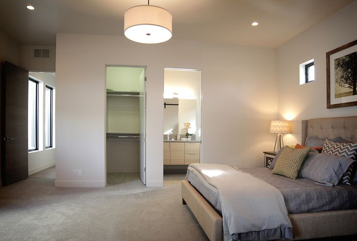 Renovare Model Home. A secondary bedroom provides ample space to relax in luxury.