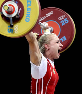 Yuliya Kalina of Ukraine competes during the women's 58-kg, group A, weightlifting competition at the 2012 Summer Olympics,
