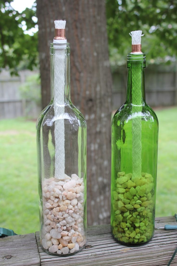 DIY Wine Bottle TIki Torches - use plumbers tape for a snug fit on the coupler and pebbles to save on fuel