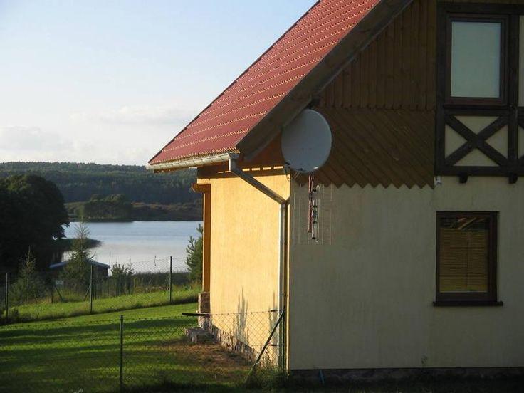 Domy i domki na Mazurach - Atrakcyjny domek nad Jeziorem Ryńskim
