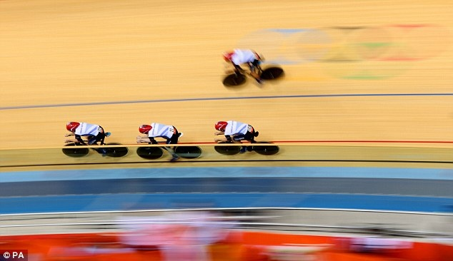 Triumphant: Team GB's cyclists smashed their own world record in roaring to gold this evening