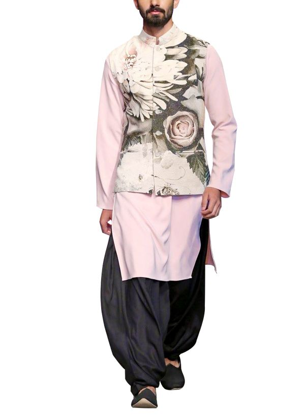 Featuring a Siddartha Tytler waistcoat with kurta and pyjama set that is perfect for a semi-formal occasion. The matka silk waistcoat features a stand collar and six button fastenings in the front. It is adorned all over with digitally printed peonies that give it a contemporary appeal. The waistcoat is paired with a pink banana crepe kurta and a grey silk patiala. Wear it to a formal or semi-formal occasion with a pair of mojris to make heads turn.