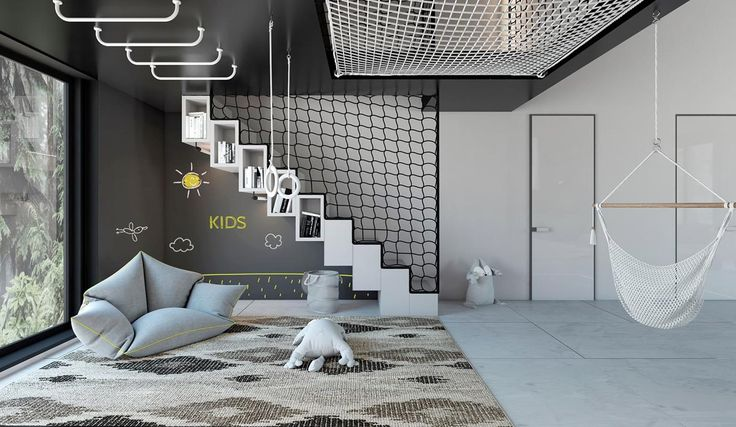 At first glance, this black and white decorated house appears as one cool serious piece of home design. Deep and dramatic belts of black walls and ceilings butt