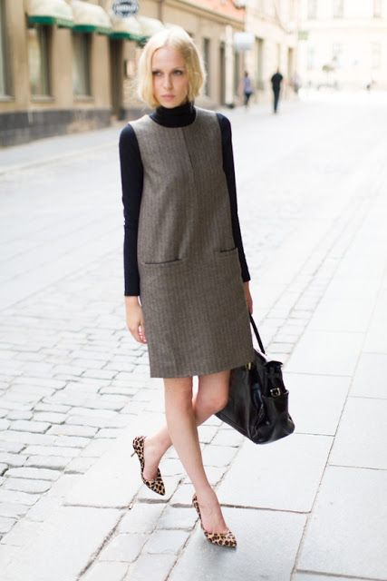 Turtleneck + shift dress is so hot this fall! The shoes with animal prints on really makes the outfit stand out more and makes it look more fun and cool.