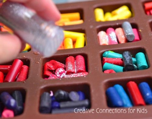 melting crayon with glitter. GREAT end of year use for broken crayons in the bucket...gifts for kids to take home.