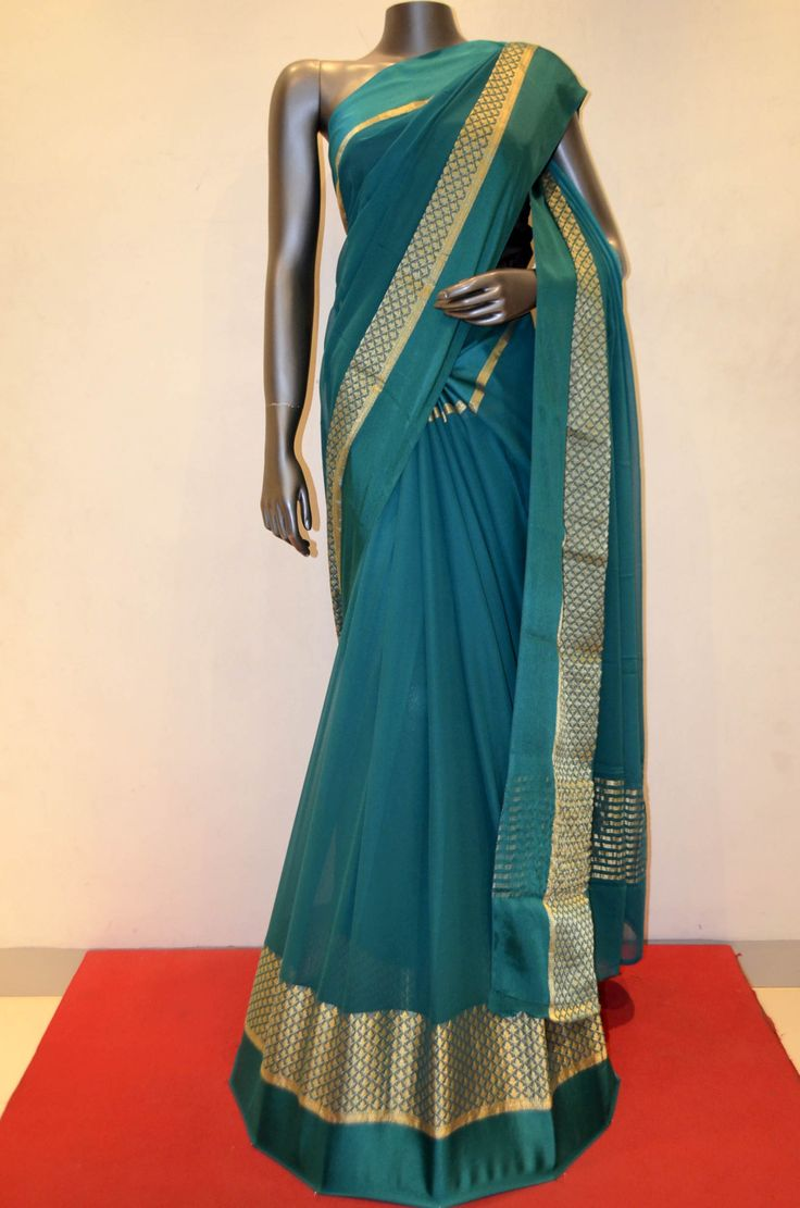 Rama Green Pure Georgette Silk With Designer Zari and Satin Border Product Code: AB211189 Online Shopping: http://www.janardhanasilk.com/index.php?route=product/product&search=AB211189&description=true&product_id=3801