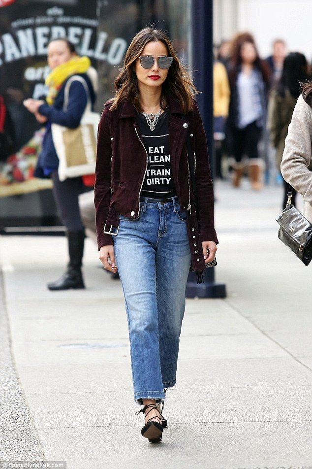 Turned-out: On Sunday 32-year-old actress Jamie Chung put all her assets to work for her as she strolled down the street in Vancouver wearing jeans, a black T-shirt and a plum-coloured biker's jacket