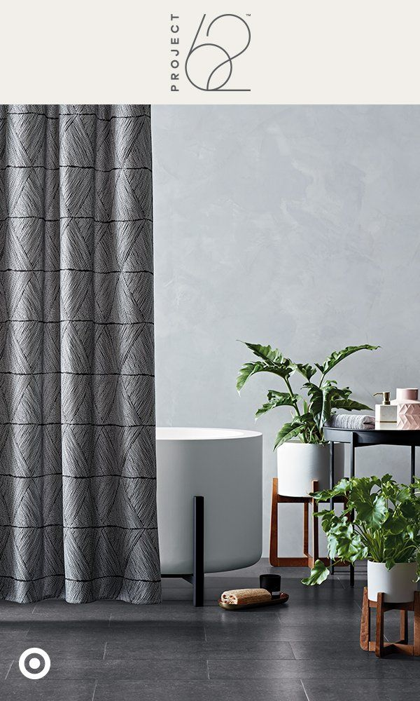 Found: Your ultimate escape. To get the look, keep it neutral and add subtle details of visual interest, like a gray shower curtain with a simple geometric pattern. Then layer in a few plant stands to bring life to your space.