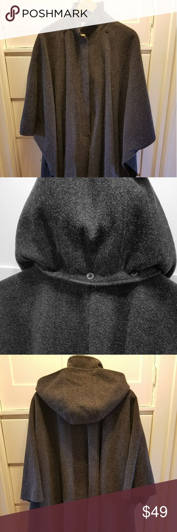 Talbots Petite dark gray wool hooded cape ONE SIZE This beautiful wool cape will carry you through the end of winter and into spring in style!   It's a one-size-fits-all Talbots Petites cape, measuring roughly 52 inches from wrist to wrist. It's very roomy. There are five hidden buttons on the front and two pockets. There is a removable hood held on with buttons. The cape measures 39 inches from the back center collar to the bottom hem.   The dark gray cape is in excellent used condition…