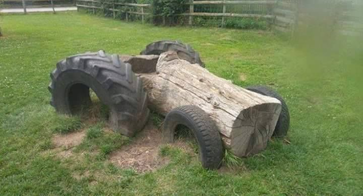 4 used tractor tires and a log create a garden tractor