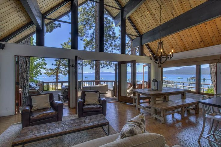 Windows to the ceiling - over three french doors  - leading out to a huge deck on Lake Tahoe| Skippin' Stones - Tahoe Lakefront Vacation Rental