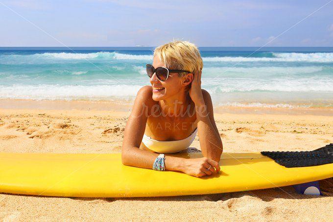 happy young woman on the beach by Trefilova Anna on @creativemarket