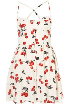 Charmed, I'm sure. The cherries and button-front are girlish and sweet. The dress needs to be worn by a Bettie Page or Marilyn Monroe type of woman.