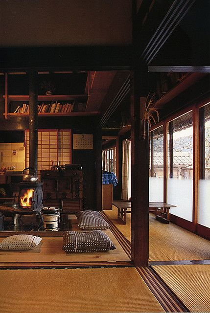 Japanese farmhouse interior with wood stove to replace original irori