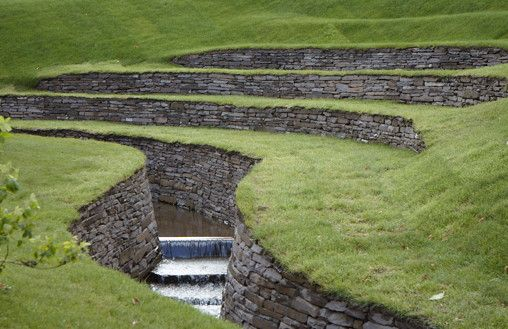 A recently completed project - a walled stream and amphitheatre at Arne Maynard's home Allt-y-bela