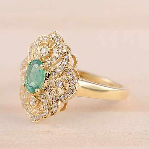 Oval Cut Emerald Engagement Ring Yellow Gold Flower Shape Diamond Wedding Band Cocktail Ring Antique Ring Anniversary Ring Unique Promise   Product Introduction *Set in solid 14k Yellow Gold  Main stone** *Type: Emerald *Weight :0.78 Carat *Color:Green  Side Stone** *Type:Diamond *Weight:0.38 Carat *Color:White  *Size: US 4-11(including full, half and quarter sizes; Please confirm your size before ordering) *choose your ring size in the drop-down menu…