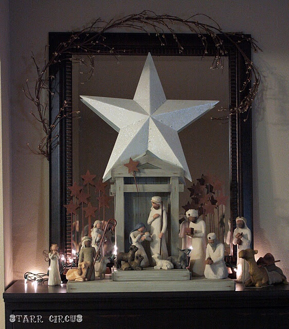 Nativity display...I like the backdrop of the mirror with the large star added to how one usually sets up a nativity scene....