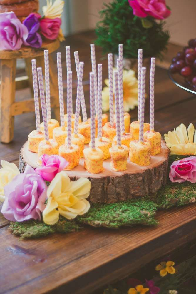 Yummy marshmallow pops at a Rapunzel birthday party! See more party planning ideas at CatchMyParty.com!
