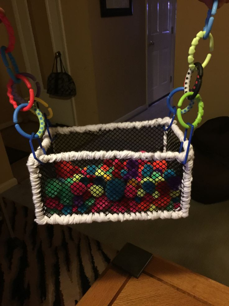 Ball pit for the Sugar Gliders. Gutter guard plastic mesh, pipe cleaners and yarn, pom-pom balls and plastic rings. Inspiration: https://www.pinterest.com/pin/264375440602608824/