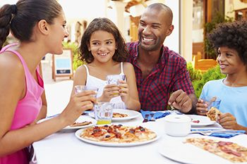 Family eating meal at restaurant together