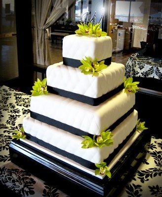 Square, 4-tier, quilted wedding cake with colorful flowers. I think this is what I want.