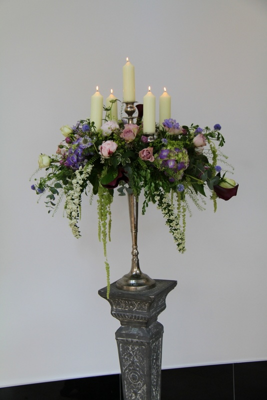 Flower Design Events: Baroque style Candelabra. Too large for table centres, but could create something similar in a scaled down size.