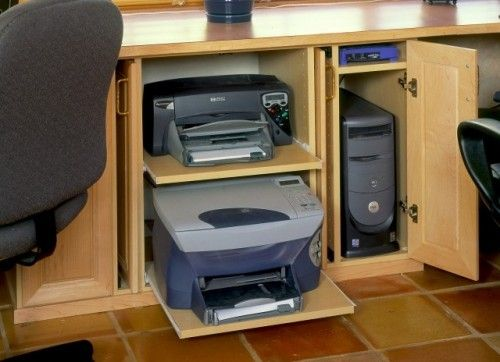 This is what a computer desk is for, to hide things, not to stock pile all those papers you no longer need