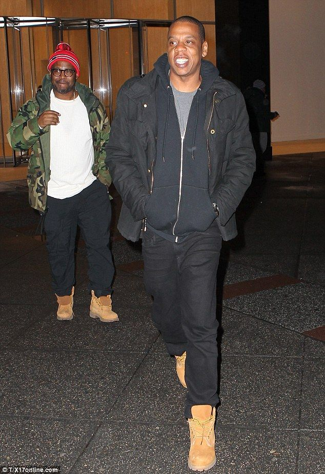 Dress-a-like pal lurking: The 45-year-old rap mogul - born Shawn Carter - matched his wife in all black over a grey T-shirt and classic Timberland boots