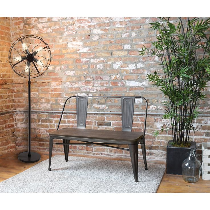 Add a stylish industrial vibe to your home with the Oregon Industrial Dining Bench. This bench features a rugged metal and wood construction with an antique finish that ensures a good fit within a variety of contemporary decors.