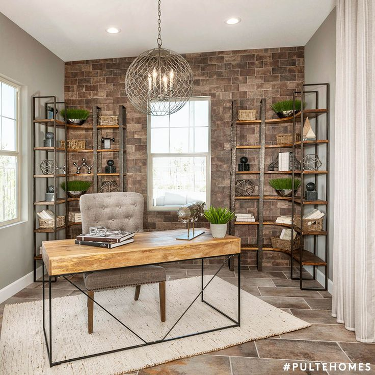 An industrial home office with ample style and storage. Tip: Plants not only add a touch of color, they're proven to boost productivity! | Pulte Homes