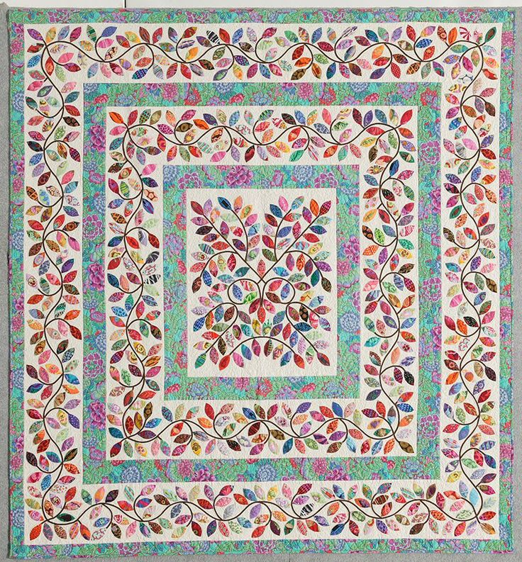 This leaves quilt is a real beauty--one that I'd never attempt. Too many tiny little leaves for me. -- Quilts that inspire