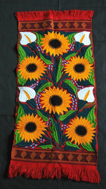 Lilies and sunflowers hand embroidered on a hand woven cotten cloth. From Zinacantan, Chiapas, Mexico, a Maya community
