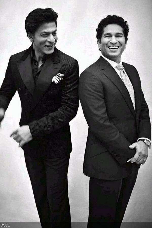 Shah Rukh Khan and Sachin Tendulkar share a light moment during a photoshoot for a magazine.