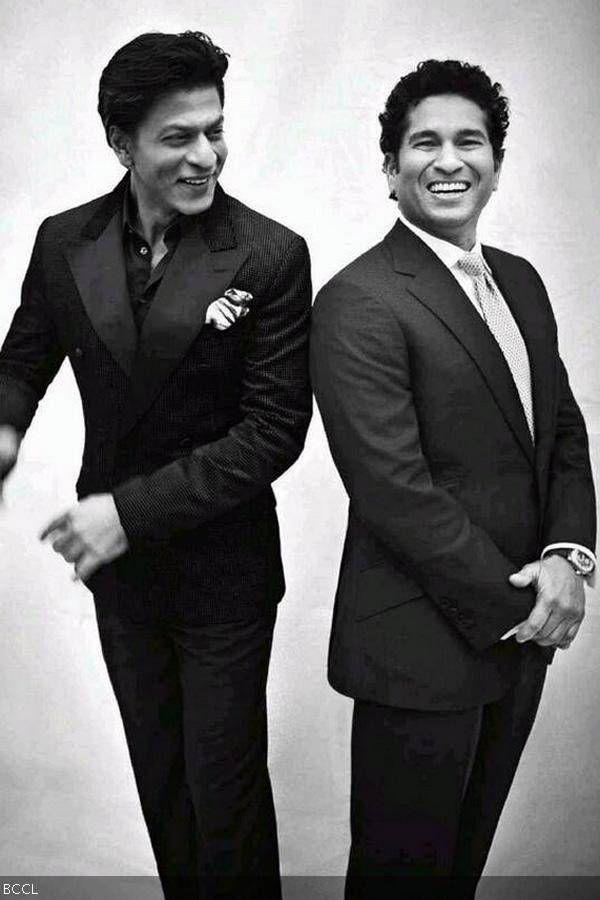 Shah Rukh Khan and Sachin Tendulkar share a light moment during a photoshoot for a magazine.