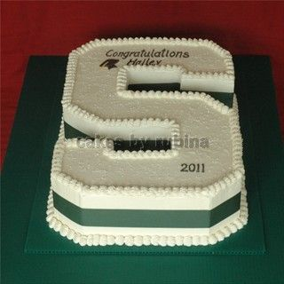 """Cutout sheet cake of a block """"S"""" made with buttercream for the Michigan State grads and incoming Spartys!"""