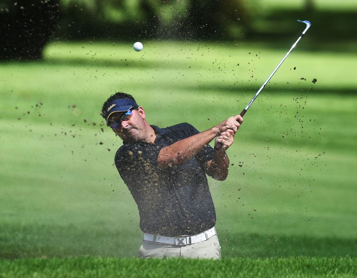 Ty Stewart chips the ball from a bunker on No. 10 at Veenker Memorial Golf Course on Sunday. Stewart won the Ames city golf tournament on Sunday. Photo by Nirmalendu Majumdar/Ames Tribune