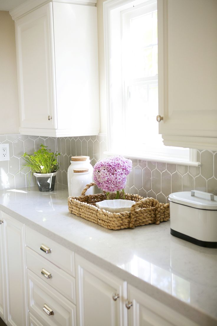 #Traditional style decor and storage #basket with pink hydrangea and quartz #countertops
