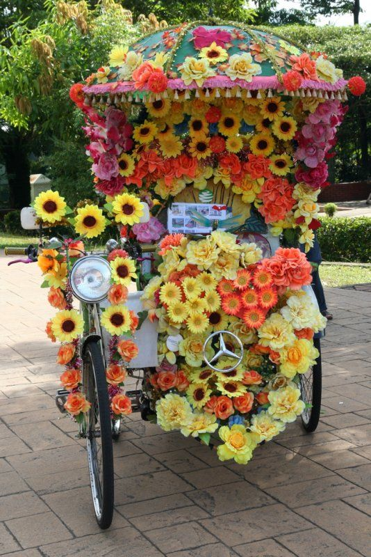 Tour Melaka's (Malaysia) Chinatown by beca, a flower-bedecked type of pedicab.