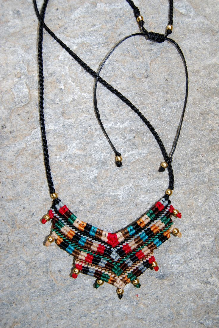 Tribal macrame necklace with waxed thread and beads.