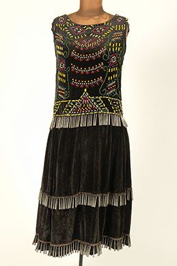 Jingle Dress. Ojibwe. Early 20th century. Velvet, glass beads, tin jingles.  I love the medling of the native and flapper styles.