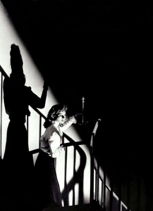 "Dorothy McGuire in a serial-killer gothic, ""The Spiral Staircase"" (1945, dir. Robert Siodmak).  These shadows shifted before her, sliding along the pale-washed wall, as though to lead the way. Whenever she entered an office, they crouched on the othe"