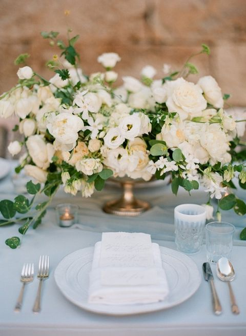 Ivory and Latte Centerpieces with Delicate Blue Linens | Vasia Photography and Artiese Studios | http://heyweddinglady.com/dreamy-blue-latte-wedding-palette/