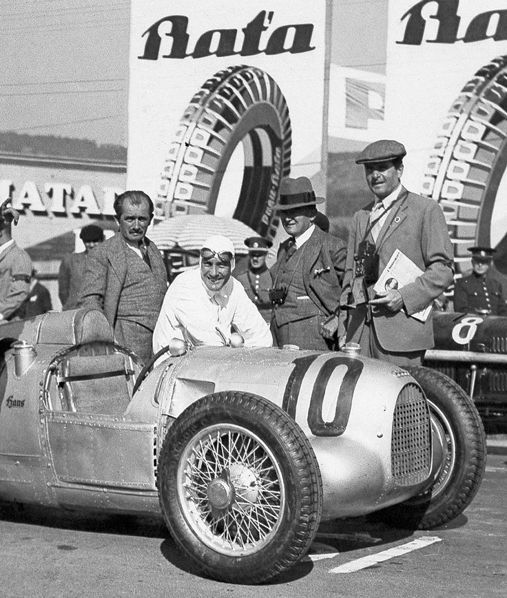 Ferdinand Porsche and Hans Stuck at Masaryk Grand Prix in city of Brno, Czchoslovakia in 1934 with the 1934 Auto Union Grand Prix racing cars Type A - In 1932 Auto Union Gmbh was formed, comprising struggling auto manufacturers Audi, DKW, Horch and Wander