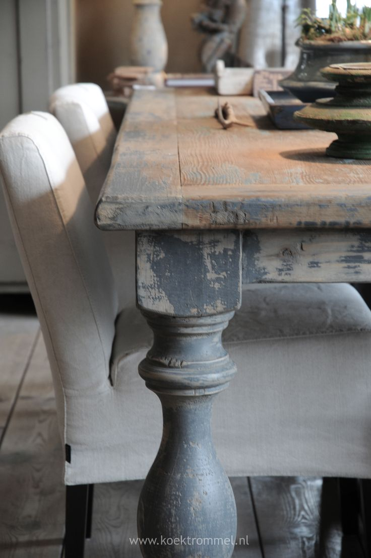 Soften a wooden table with upholstered chairs mix it up for Distressed white dining table