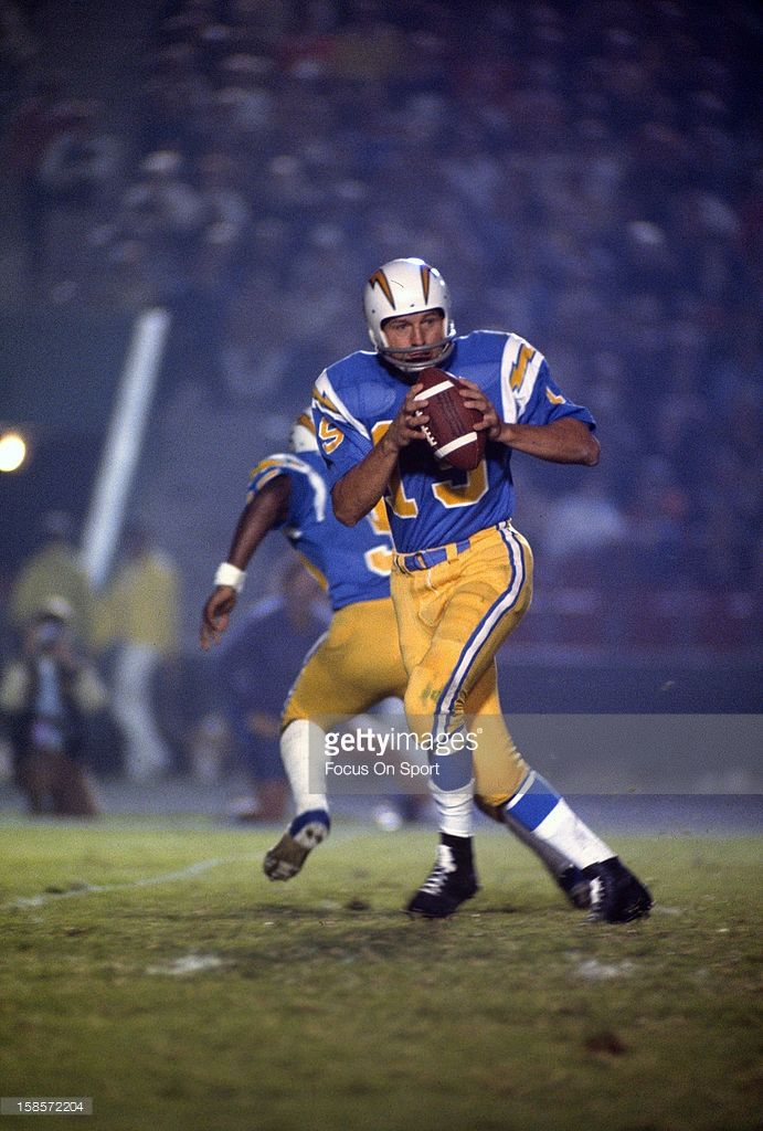 Quarterback Johnny Unitas #19 of the San Diego Chargers drops back to pass against the Los Angeles Rams during a pre-season NFL football game circa 1973 at Jack Murphy Stadium in San Diego, California. Unitas played for the Chargers in 1973.