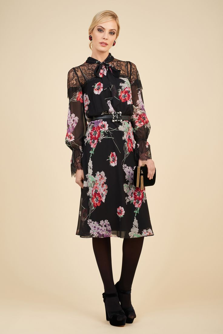 Printed silk georgette dress with lace insert with Imao bag.