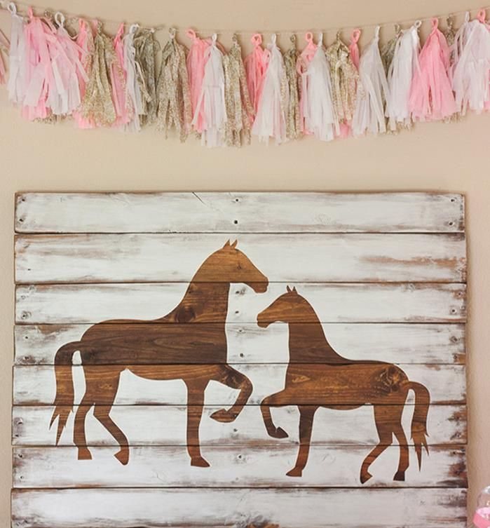 Backdrop / Banner made with a pallet at a vintage pony party.  I like the idea but with a different silhouette.