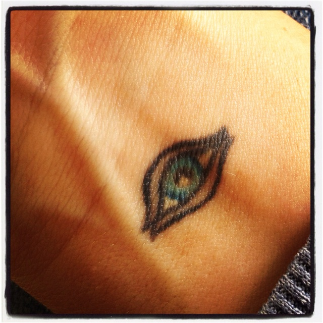 """One thing I will never regret doing! """"the evil eye"""" .. Means the total opposite .. It wards off Evil"""